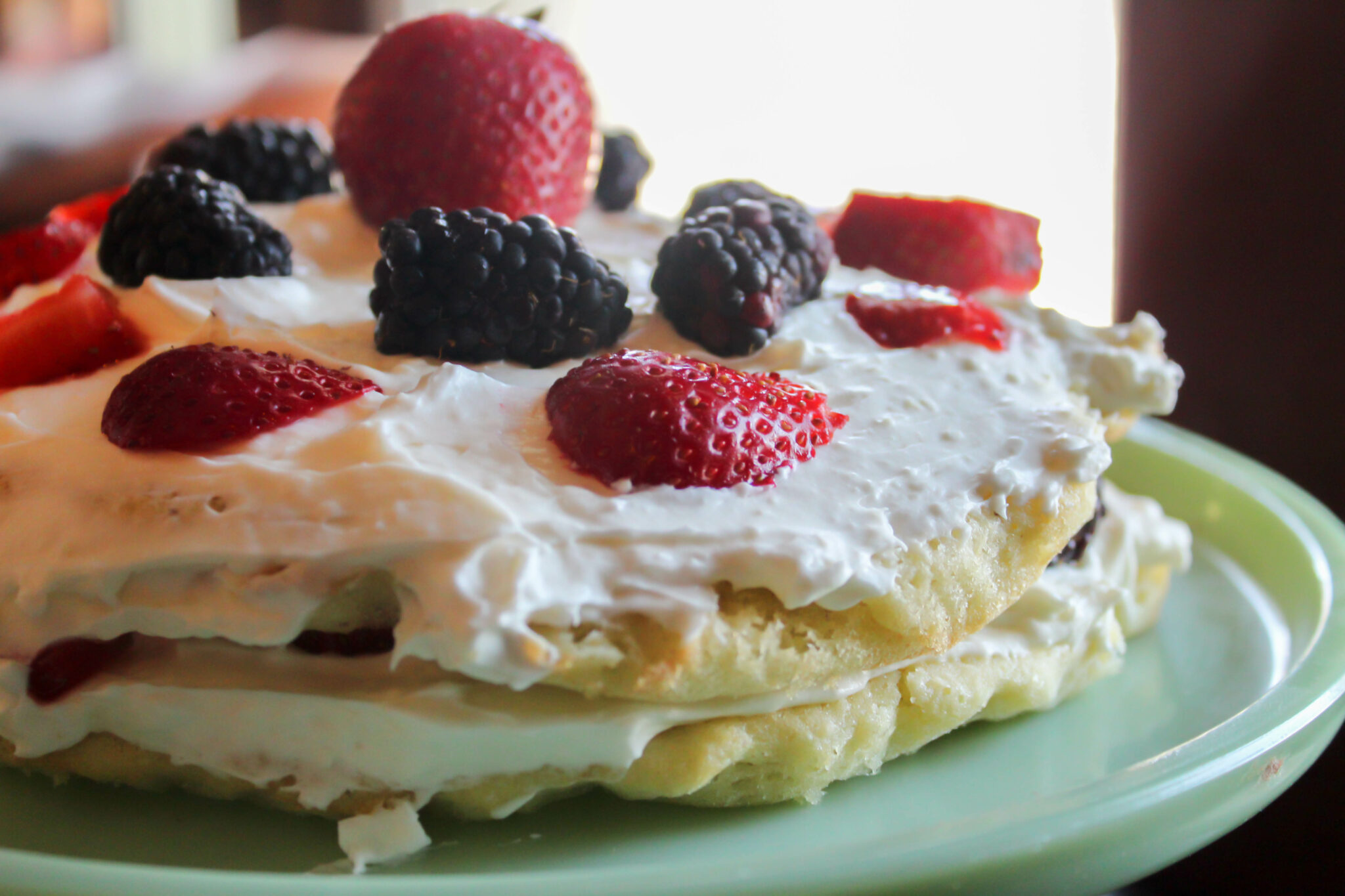 My Berries and Cream Cake is not only delicious but beautiful! It has two decadent layers stuffed with a cream cheese icing and berries!